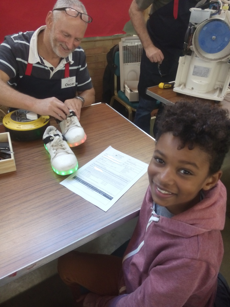 Repairer with child and his usb flashing shoes